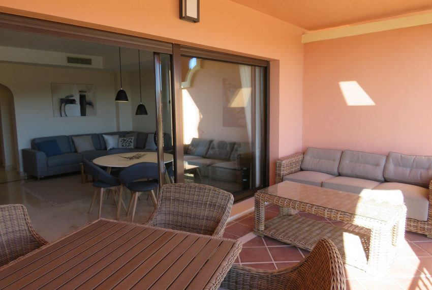 selling-townhouse-in-spain-estepona-spain-view-living-room-terrace