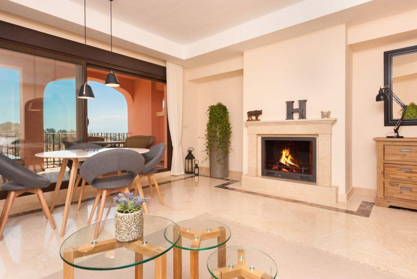 townhouse-buy-lounge-chimney-estepona-golf-seaviews